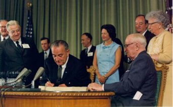 President Johnson signs Medicare bill