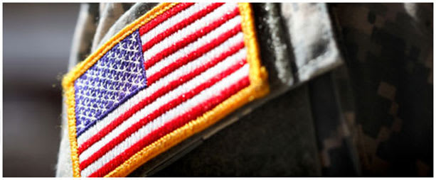 close-up image of american flag patch on a soldier's uniform