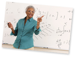 Senior person teaching a class in front of a white board.